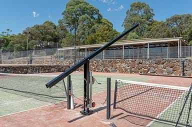 Tennis court lighting pole